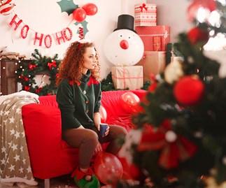 Woman looking sad at Christmas