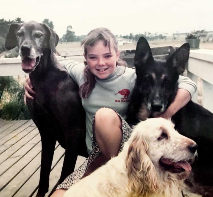 Aged 10 with her uncle's rescue dogs.