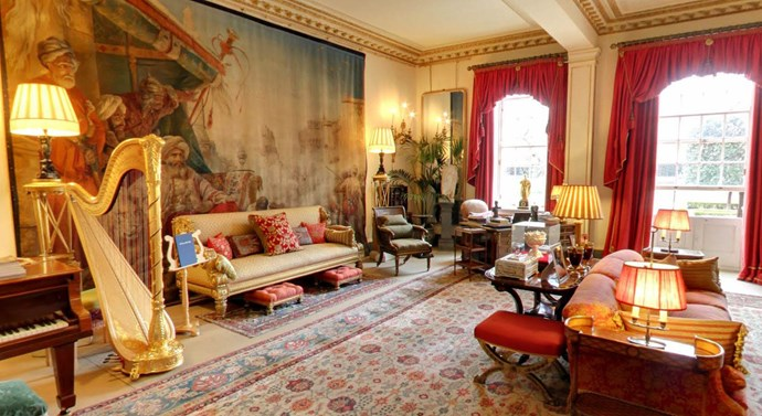 **The Garden Room.** This room was created by The Queen Mother from two rooms, which formed part of the 1870s extension. It offers beautiful views out onto the garden, from which the room gets its name, and is also home to a grand piano and golden harp.