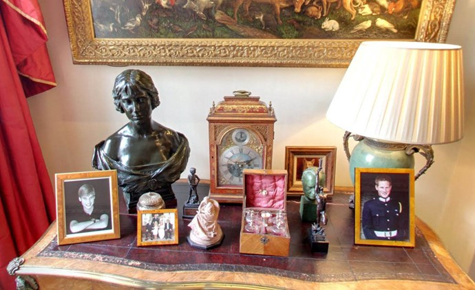 Photos of William and Harry are displayed near the windows which look out to the impressive garden that Prince Charles had designed in memory of his Grandmother, The Queen Mother.