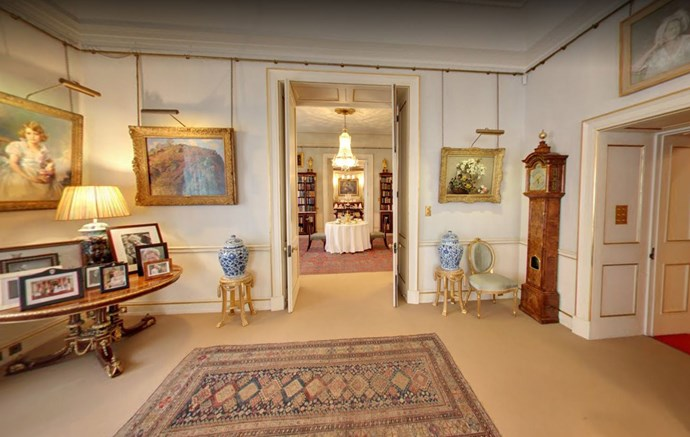 The Morning Room was said to be The Queen Mother's favourite room in the house. It has doors through to the Library. To the left is a collection of family photos and sitting above is the first official portrait of Princess Elizabeth, painted when she was seven years old.