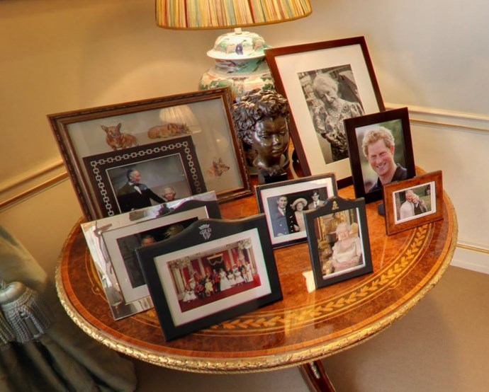 Family photos including The Queen, Charles and Camilla, a candid photo of Prince Harry and an image of Charles' beloved Grandmother The Queen Mother, sit proudly at the end of The Morning Room.