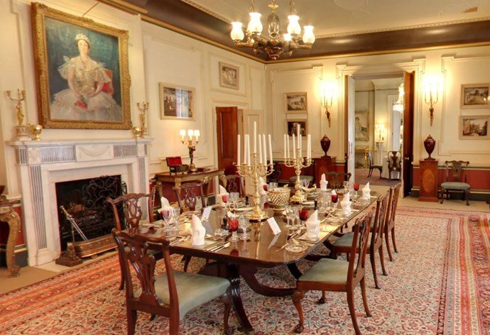 The ceiling in The Dining Room is accented by striking bronze coving, which was added by The Prince of Wales and The Duchess of Cornwall. Above the fireplace is a portrait of the late Queen Elizabeth The Queen Mother.