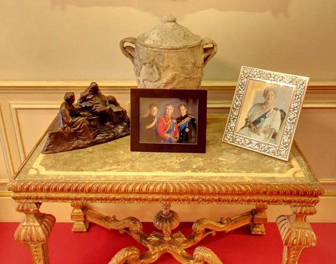 It also displays some treasured photographic memories. Here, a photo of Prince Charles, Prince William and Prince Harry in their military uniforms sits next to a photo of The Queen Mother.
