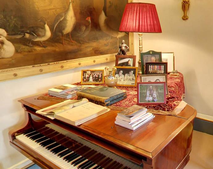 The Garden Room is said to be Prince Charles' favourite room in the house. Many of Charles and Camilla's private photos have pride of place on the piano.