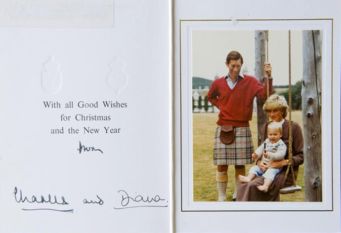 Proud father Charles looks on as Diana poses with William on a swing in their 1983 Christmas card.