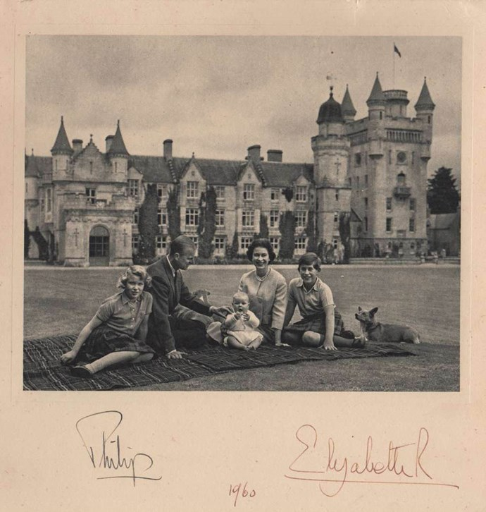 The Queen and Prince Philip sent this card out in 1960, posing on a rug on the lawns of Balmoral Castle with their children Princess Anne, Prince Charles and a bonny wee baby Prince Andrew. With obligatory corgis in tow, of course.