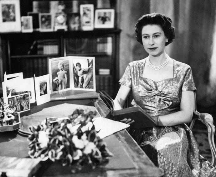 Queen Elizabeth in the Long Library at Sandringham on Christmas Day in 1957. This was the first year the Christmas Day broadcast was televised.