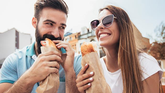 Couple eating baguettes