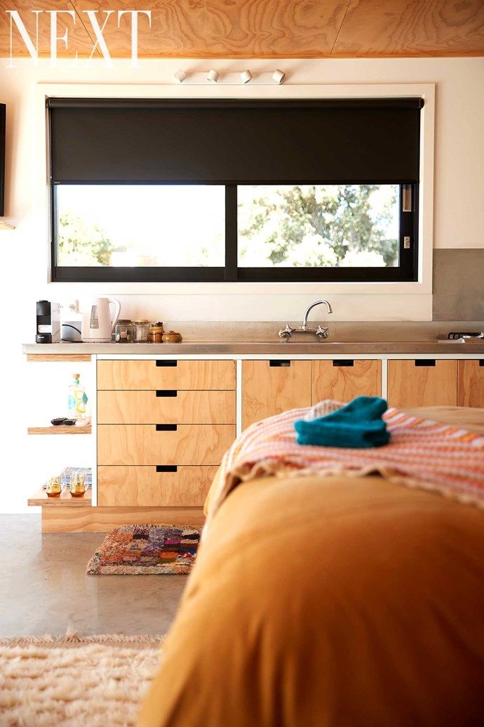 The Airbnb studio comes complete with a plywood kitchenette.