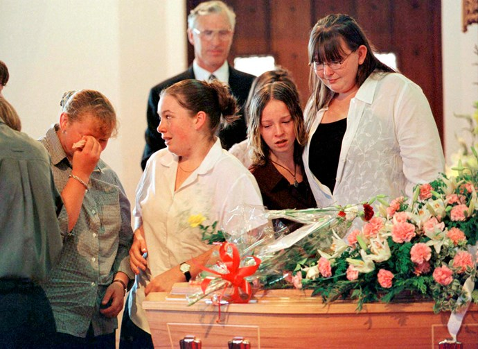 Lee-Anne (far right) grieves with her friends around Kirsty's coffin in 1999.