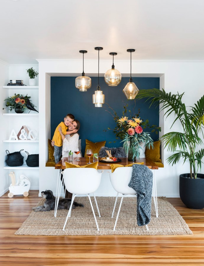 Featured on the cover of *Your Home and Garden*, the dining booth was created to overcome a spatial problem but has become the star of the home with its striking lighting and rich colour scheme.