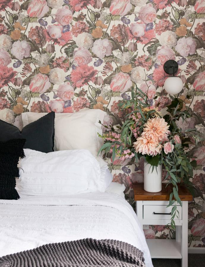 The wallpaper, combined with blush full-length curtains, floor-to-ceiling mirrored wardrobe doors and beautiful linen and lighting, has given the room a modern, romantic look that Alice loves.