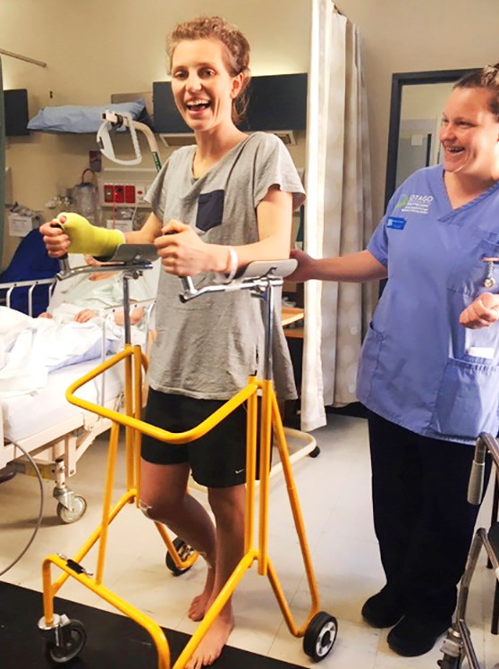 After weeks of recovery, the avid athlete is walking again.
