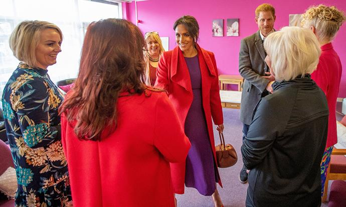 Meghan and Harry greet representatives from Tomorrow's Women Wirral. *Image: Getty*