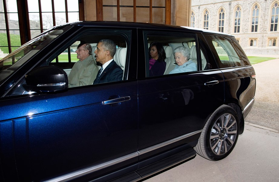 Prince Philip driving former US President Barrack Obama and his wife Michelle along with the Queen during a visit to their estate. *(Image: Getty)*