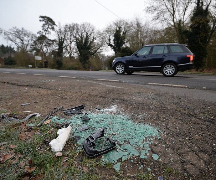 The smashed glass and car parts left behind at the site of Prince Philip's car crash.