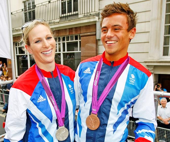 Zara celebrating Olympic glory with diver Tom Daley *Image:Getty*