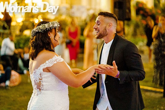 """The besotted groom serenades his beautiful bride to James Arthur's """"Say You Won't Let Go""""."""
