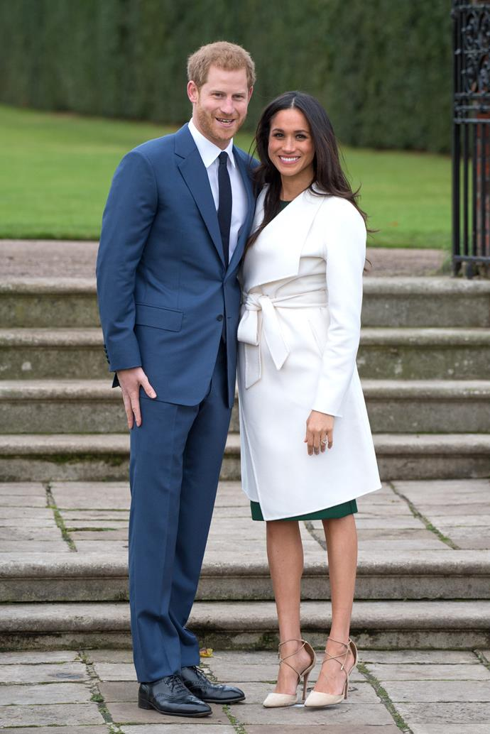 Duchess Meghan looks to have worn the same Aquazurra heels to the National Theatre that she did when her and Prince Harry announced their engagement. *(Source: Getty)*