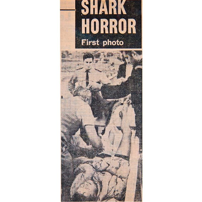 A news clipping shows the gory scene when Barry was brought out of the water, on the beach where a surfer had been eaten whole in a previous attack.