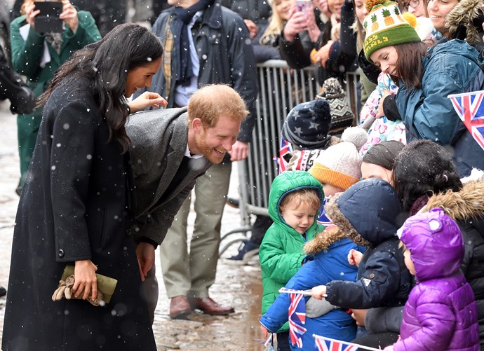 Meghan and Harry stop to talk to pre-school children during their public walkabout at Bristol Old Vic. *(Source: Getty)*