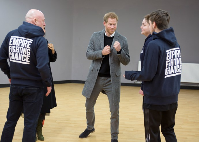 Harry and Meghan talk with Lestyn and Sarah, who have benefited from the work that Empire Fighting Chance do. *(Source: Getty)*