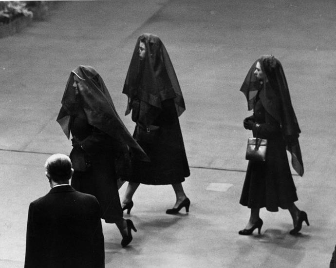 Queen Elizabeth II, the Queen Mother and Princess Margaret attending King George VI's funeral. *(Image: Getty)*