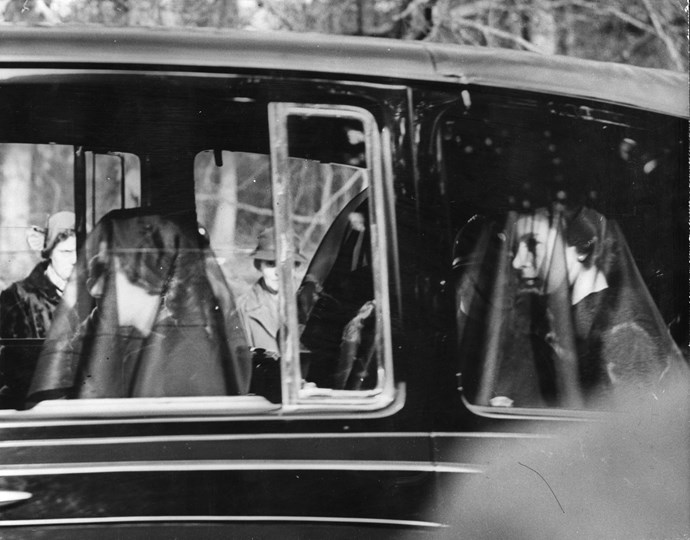 Queen Elizabeth II and Princess Margaret in the mourning cortege of their late father King George VI in 1952. *(Image: Getty)*