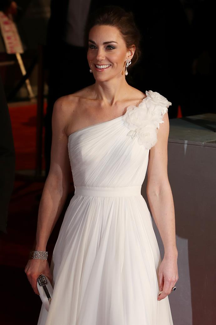 Kate looked radiant in an all-white, one shoulder gown by Alexander McQueen. *(Image: Getty)*