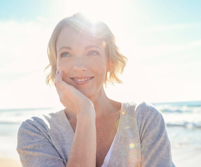 mature woman smiling at beach