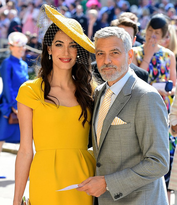 Amal and George Clooney arriving at Meghan and Harry's wedding at Windsor Castle. *(Image: Getty)*