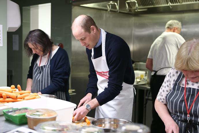 Prince William helped out in the kitchen at The Passage, helping the head chef make spaghetti bolognese. *(Image: Getty)*