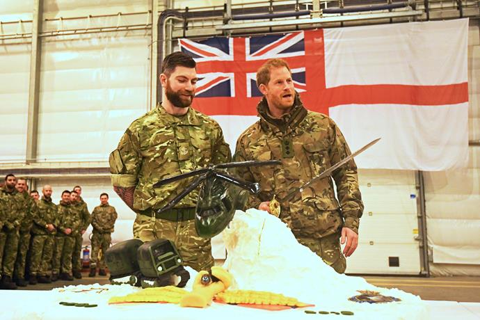 Prince Harry cuts the Exercise Clockwork 50th anniversary cake in Norway. *(Image: Getty)*