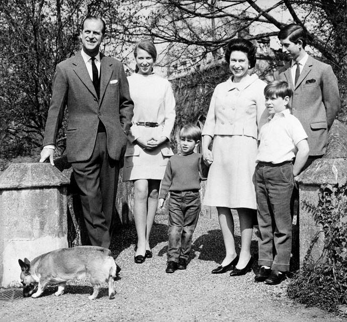 The Royal family in the gardens of Windsor in 1968. From left: Prince Philip, Princess Anne, Prince Edward, the Queen, Prince Andrew and Prince Charles. *(Image: Getty)*