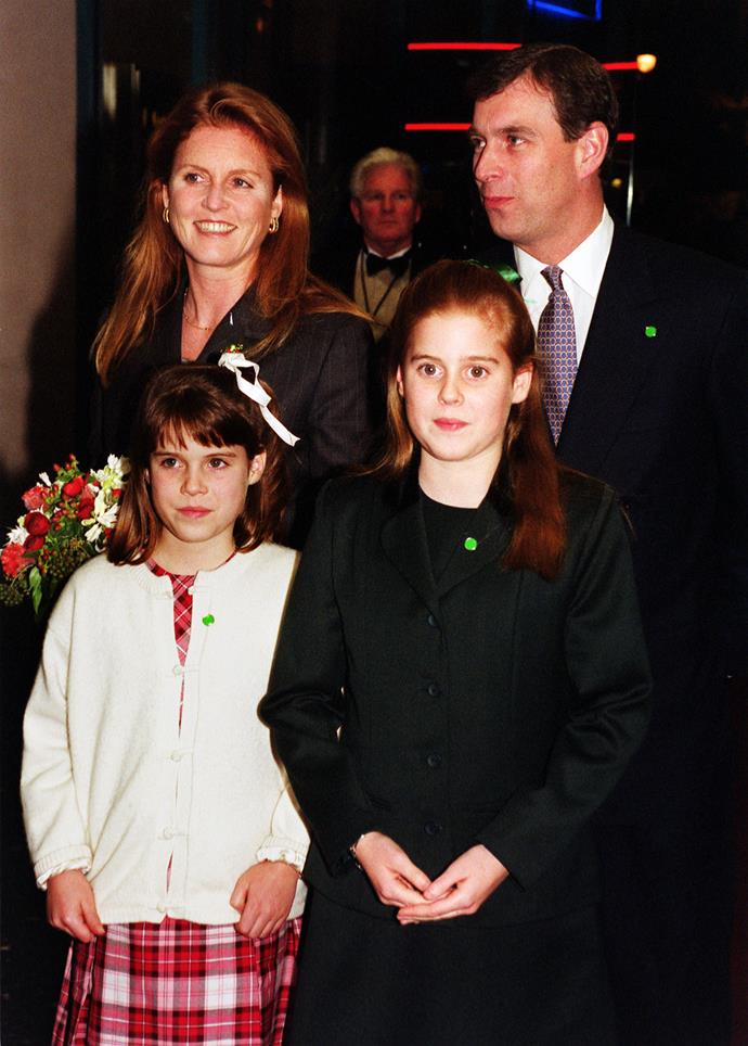 Prince Andrew and Sarah Ferguson with their daughters Princess Eugenie and Princess Beatrice in 1999. The couple have stayed remarkable close despite finalising their divorce in 1996. *(Image: Getty)*