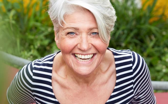 Portrait of happy mature woman in garden