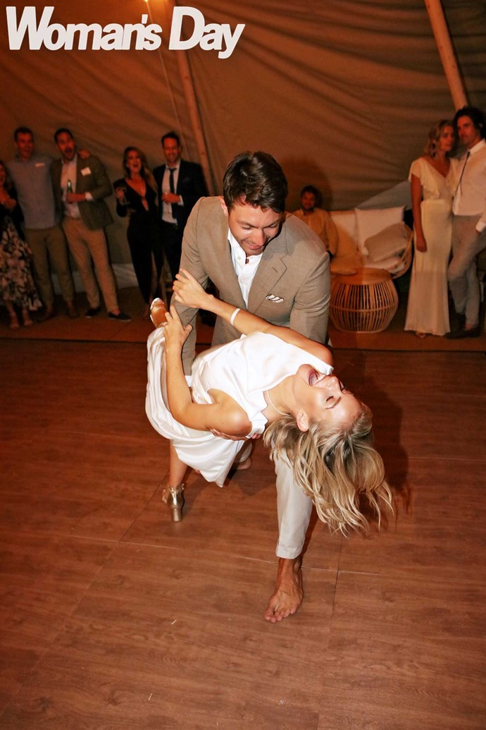 The newlyweds share their first dance to Neil Young's *Harvest Moon*.