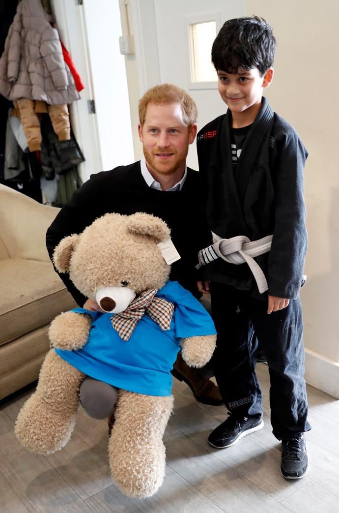 Prince Harry poses with a young participant during a visit to a 'Fit and Fed' campaign. (*Image: Getty)*