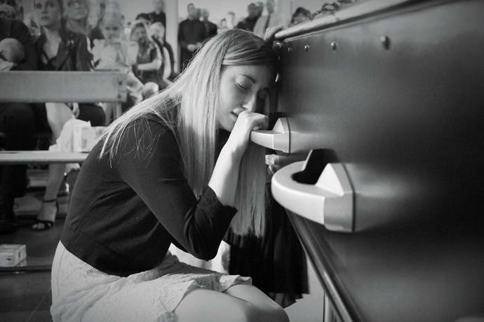 A bereft Zoe beside her husband's coffin.