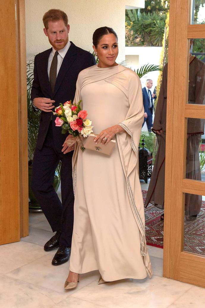 The Duke and Duchess of Sussex made a stylish entrance at a reception hosted by the British Ambassador to Morocco. *(Image: Getty)*