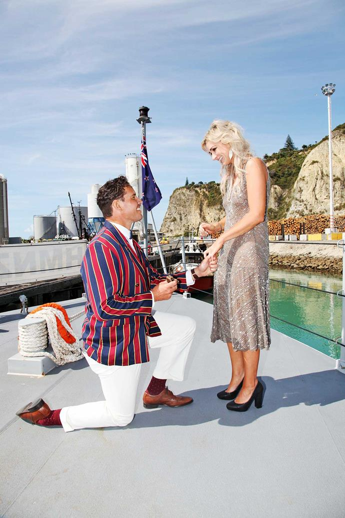 Dressed to the nines aboard the HMNZS Hawea in Napier (above), Zac popped the question to a surprised Erin.