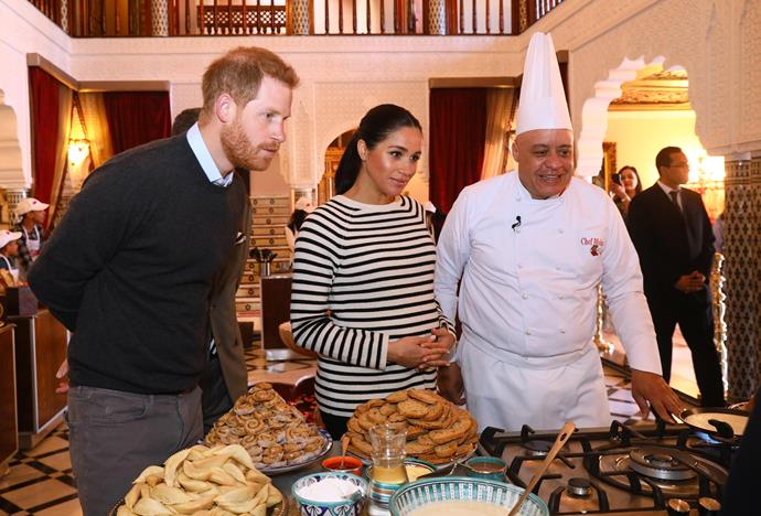 Prince Harry and Meghan watched a cooking demonstration, led by on of the country's top chefs, Chef Moha Fedal. *(Image: Getty)*