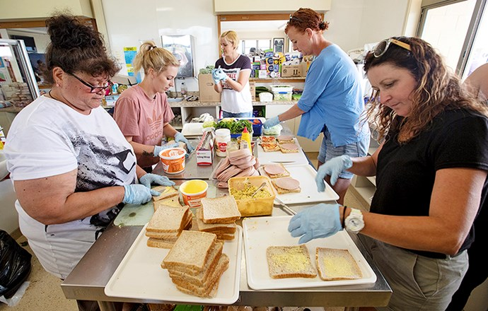 Volunteers preparing meals to feed emergency services crews. *This photograph and the others, below, by Tim Cuff.*