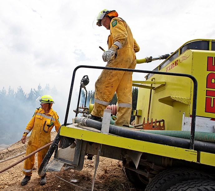 Firefighters fight smoke billowing across Teapot Valley.