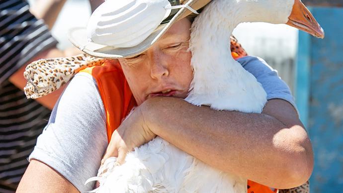 Margaret Skippy Napier hugs a goose Nelson wildfires