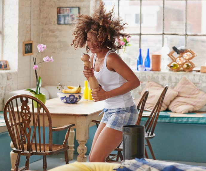Single woman dancing in pyjamas