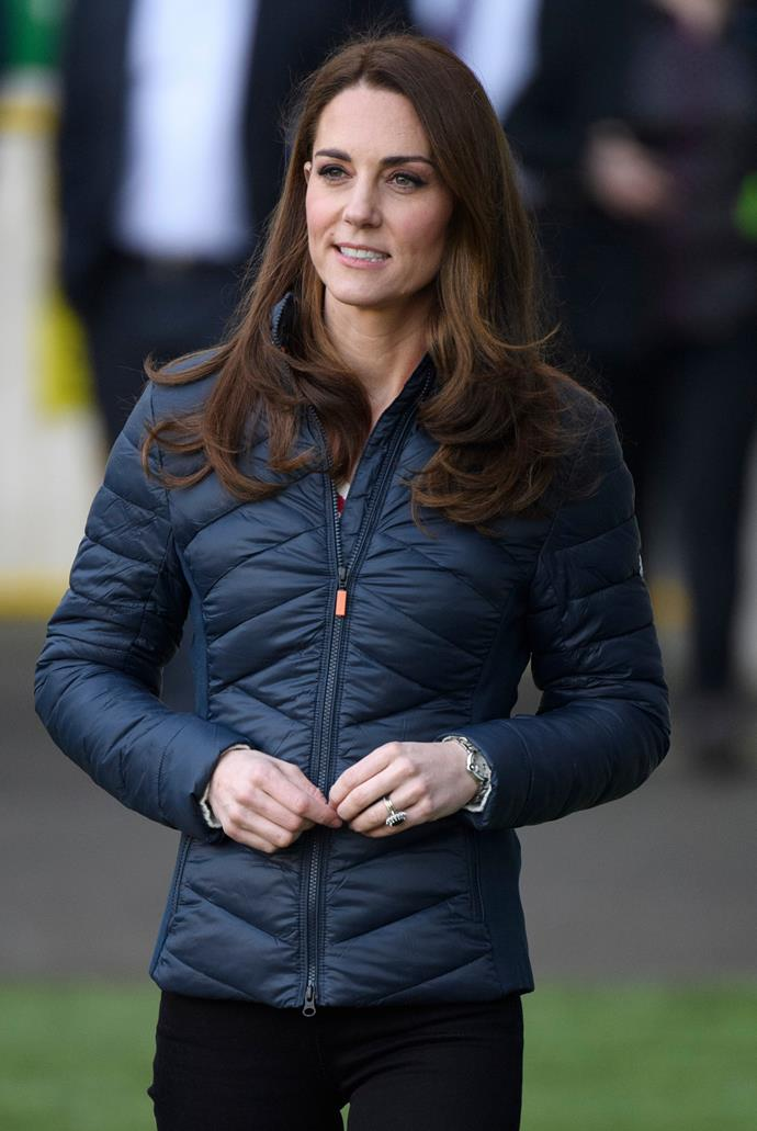 The Duchess changed out of a vibrant red Carolina Herrera coat and into more practical activewear for a day of sports. *(Image: Getty)*