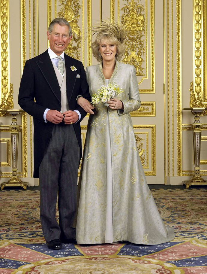 **The Duchess of Cornwall, 9 April 2005** <br><br> Camilla Parker Bowles married heir to the throne, Prince Philip on April 9, 2005 at the Windsor Guildhall. <br><br> Designed by Robinson Valentine, her floor-length gown featured an embroidered pale blue and gold coat worn over a matching dress gown and she accessorised with a dramatic spray of golden feathers in her hair.