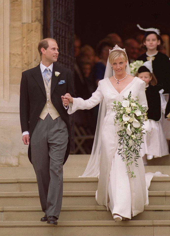 **The Countess of Wessex, 19 June 1999** <br><br> The Queen's youngest son, Prince Edward married Sophie Rhys Jones at St George's Chapel on June 19, 1999. <br><br> The Countess of Wessex wore a hand-dyed silk organza and silk crepe gown designed by Samantha Shaw. <br><br> Full length with long sleeves, it featured pearl and crystal beading details and she accessorised with a black and white pearl necklace with matching earrings designed by Prince Edward and wore a diamond tiara, lent to her by the Queen.